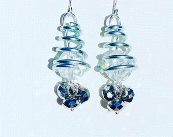 Springs, Bling and shiny earrings made out of czech glass set on a silver metal spring