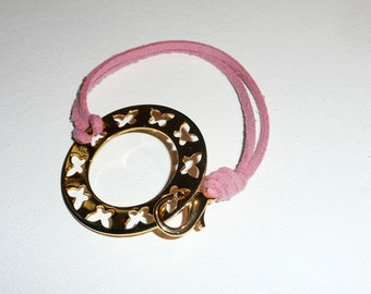 PinkButterflies. Fun pink soft leather bracelet with a gold plated silver donut full of butterflies.