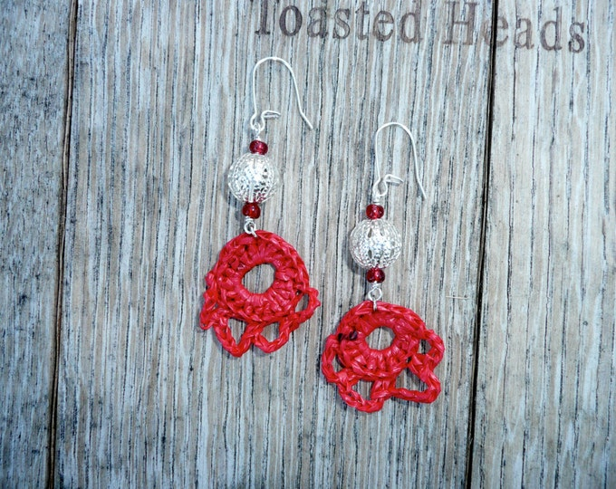 Blushing - Unique half flower shaped earrings made out of a recycled shopping bag with a silver filgree bead.