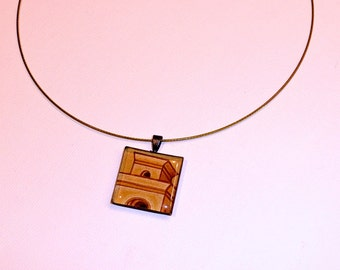 Minarete - Gunmetal square resin pendant on a dark blue wire featuring a tower drawing.