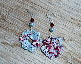 Flower up pearls - Unique flower shaped earrings made out of a recycled shopping bag with a glass pearl and a red glass bead.