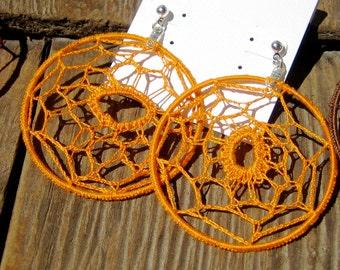 Webloops - Unique orange crocheted earrings.