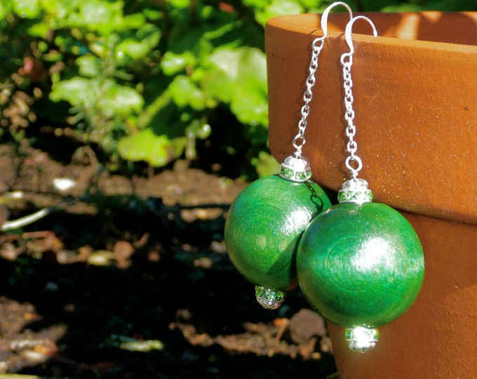 Sandia - Statement earrings with a wooden dark green ball and matching Swarovski rondelles.