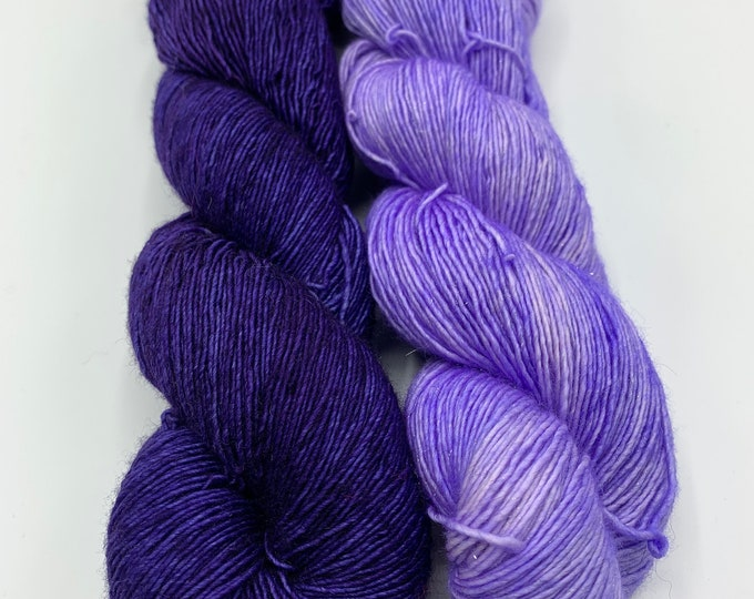 set of 2 skeins - merino single in you are loved, sparkly merino single in OOAK purple