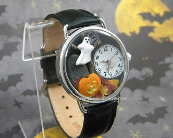 Spooky Halloween Watch with or without bats, it has glow-in-the-dark pumpkin face and edge of ghost, autumn leaves tombstone moon, tree