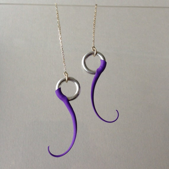 Monoplume mini earrings with soft rubber spines