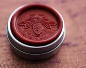 Aurora Solid Natural Perfume in a Round Tin with honey bee wax seal - Flower Power, an oriental fragrance with spicy, carnation floral notes