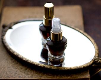 Figure 1: NOIR Natural Eau de Parfum, 4 grams - This patchouli perfume smells like a deep, dark red wine with nocturnal, woody, merlot notes