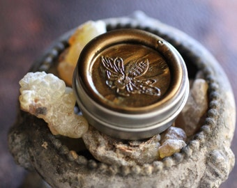 Aumbre Solid Natural Perfume Round Tin with Honey Bee Wax Seal - An Amber Chant - Smokey, sweet incense fragrance, a customer favorite