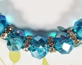 BF-320; Beautiful Aurora Borealis Faceted Turquoise Glass Bead Strand Accented with Faceted Glass Spacer Beads