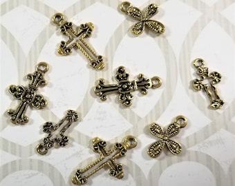 C-127; Eight Tiny Assorted Antique Brass Crosses