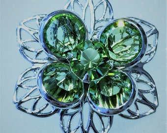 E-174, A Beautiful Silver Toned Flower with Green Swarovski Crystals in the Center