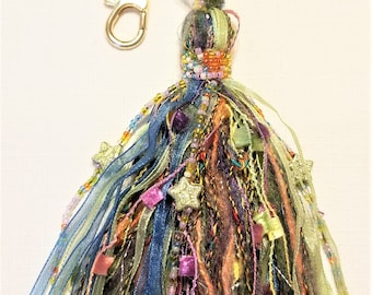M-135, Multi Colored and Textured Tassle with a Lobster Claw Hook