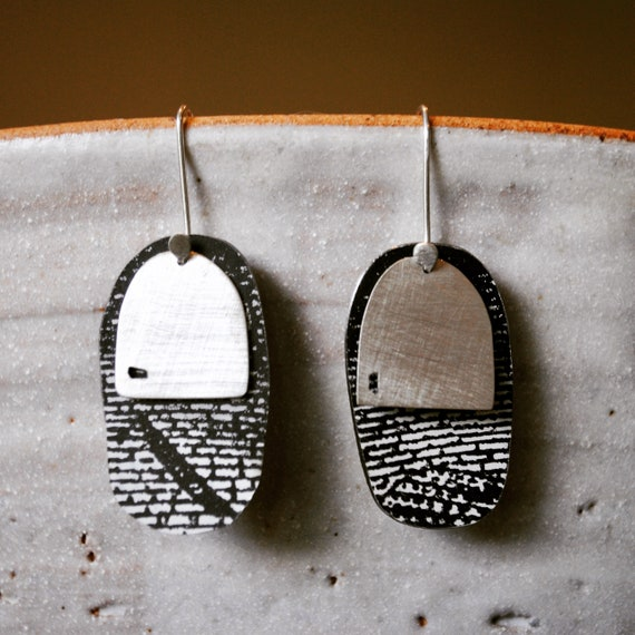 Black white and silver drop earrings.