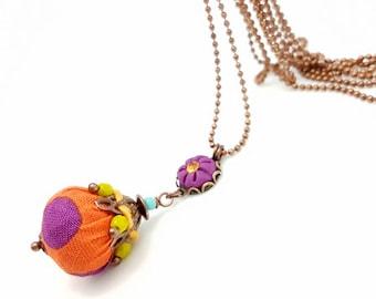 Long necklace purple clay, orange fabric