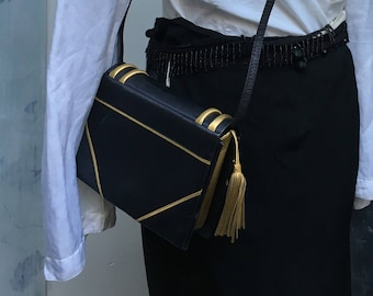 vintage clutch Paloma Picasso book navy gold leather