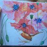 Wren under poppies horizontal