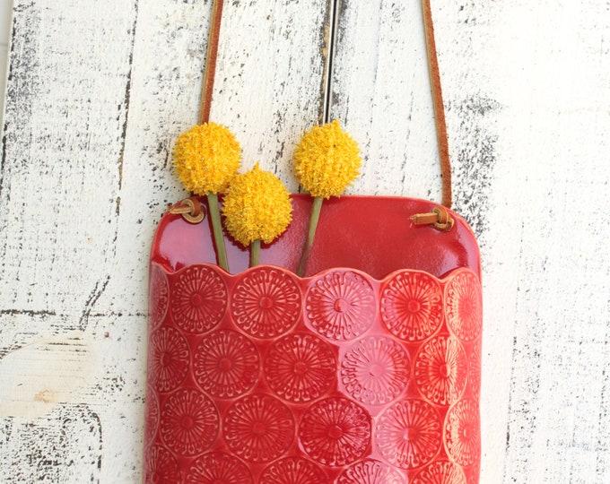 red hanging wall vase