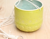 lime green hanging planter with cotton cord hanging plant container