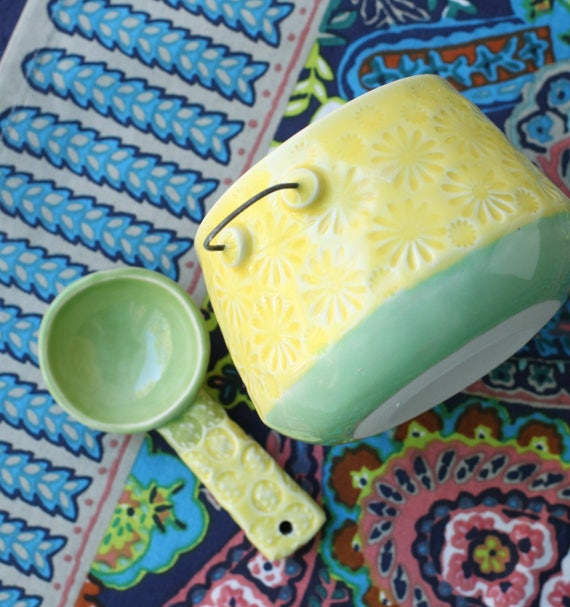 yellow and green bowl and spoon