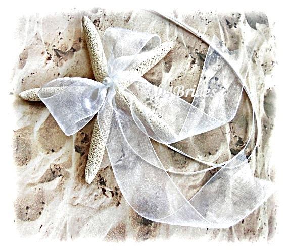 White starfish ring barrier pillow and matching  starfish garter.