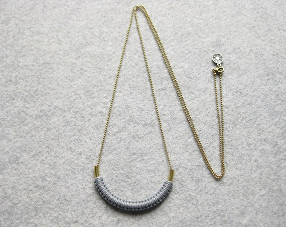 V A R O A . Brass Tube Pendant on Long Chain with Macrame Fiber Detail . Modern Minimalist Textile Jewelry . © Design par .. raïz ..