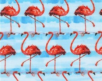 228249 Robert Kaufman flamingo fabric in light blue