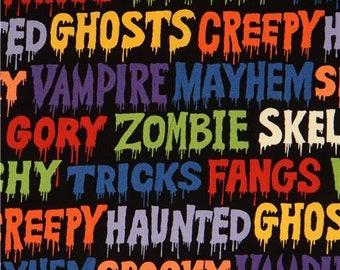 227627 black Halloween words fabric by Alexander Henry