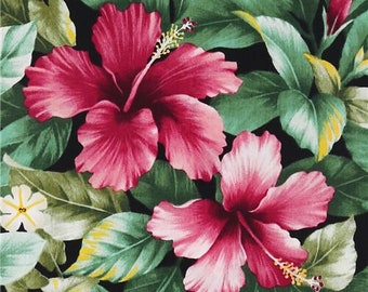 246653 black Hawaiian flowers fabric hibiscus and green leaves by Trans-Pacific Textiles