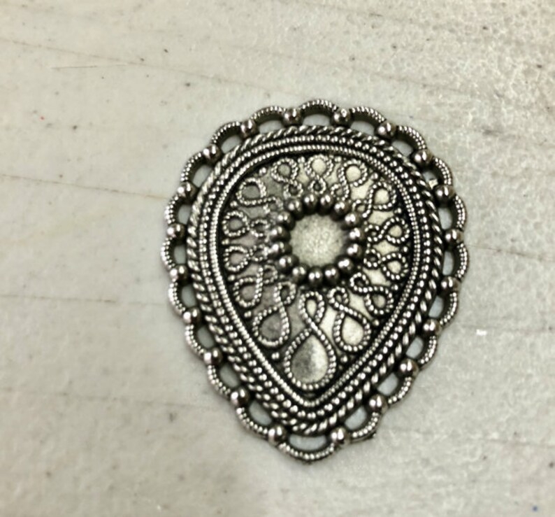 Button or other embellishment, 34mm x 40mm, rope edge , sold in 3 packs  09504AS