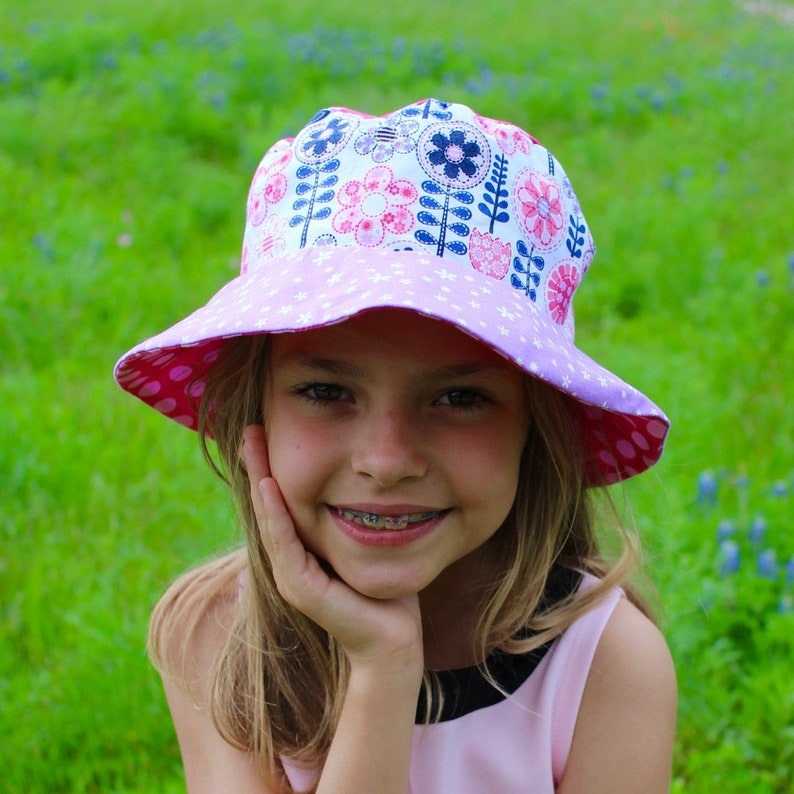 537aaf8f7 Girls bucket hat, pink and purple flower hat, reversible sun hat for girls