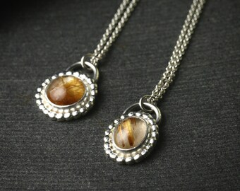 sterling silver and rutilated quartz pendant