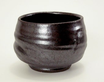Lovely deep reddish brown teabowl on dark stoneware clay