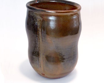 Art-vase with textures approximately 9 inches tall by 6 1/2 inches wide with traditional shino glaze
