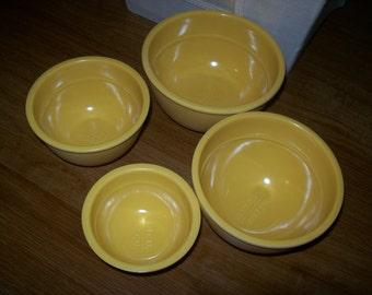 4 yellow  nesting measuring bowls