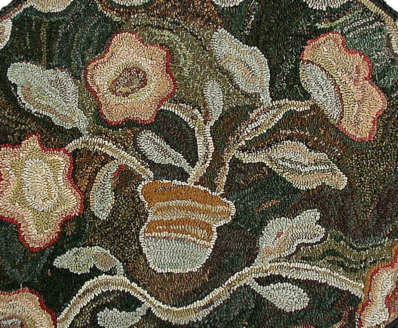Oval Antique floral rug hooking pattern on primitive linenKaren Kahle hooked rug design