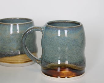 Hand Thrown Porcelain Coffee Mug in  Floating Blue and Amber Glaze