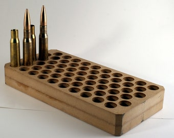 Standard ammo can liner for transporting .50 BMG cartridges