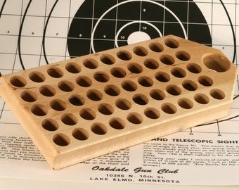 Maple reloading block with standard holes for larger pistol calibers