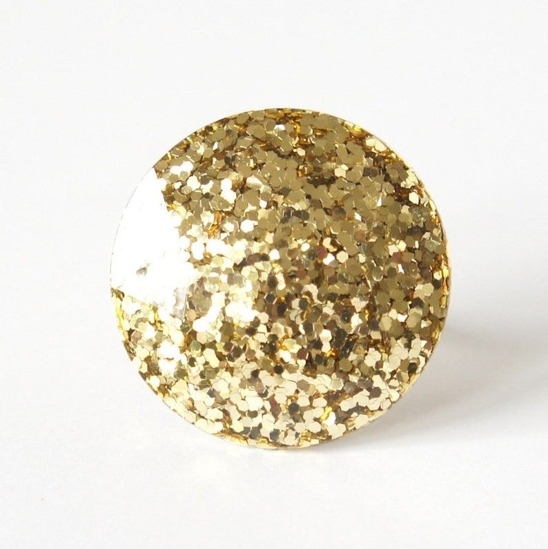 Round Resin Ring Abstract chunky large gem gemstone statement costume piece in gold glitter.