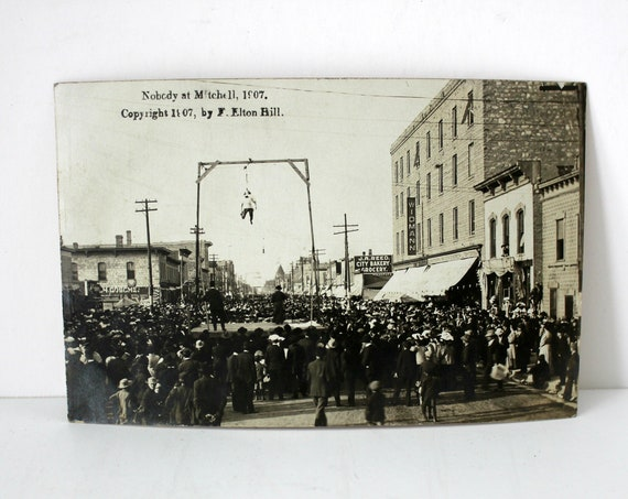 Nobody at Mitchell SD, South Dakota RPPC 1907 Stunt Man, Daredevil, Carnival Act, Street Scene Vintage Postcard