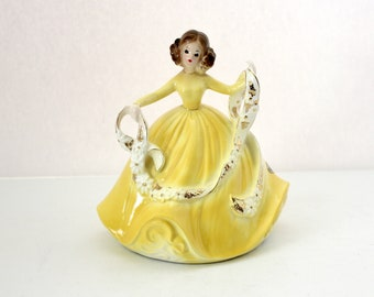Vintage Josef Originals Girl in Yellow Dress with Floral Ribbon Figurine