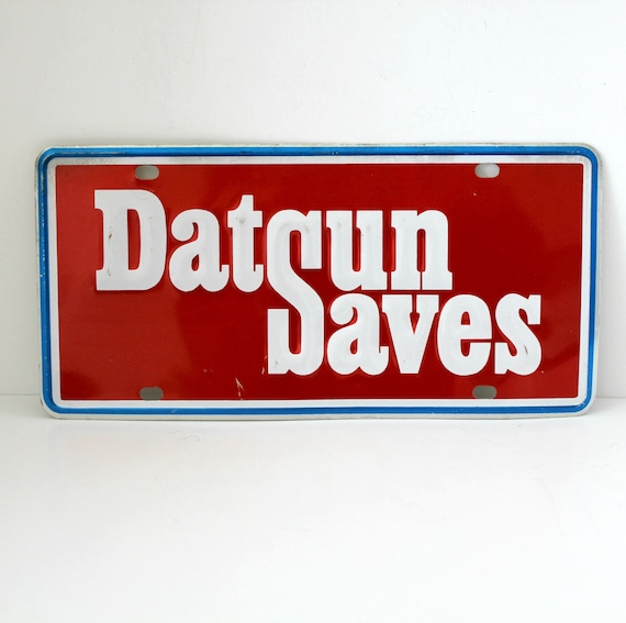 Vintage Datsun Saves Dealer License Plate, Aluminum Car Dealership Advertising
