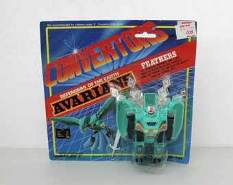 Vintage  Convertors Defenders of Earth  Avarians Feathers MIP New in Package, Converts Robot to Peacock