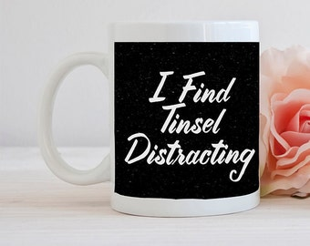 I find Tinsel Distracting Seinfeld inspired Festivus Mugs!