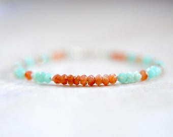 African sunstone and amazonite beaded  bracelet. coral sunstone and aqua blue amazonite. sterling silver detail. aqua blue and coral