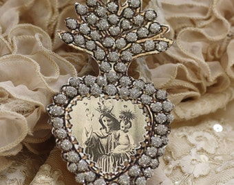 Crowned Mother and Child - a paper ex-voto locket