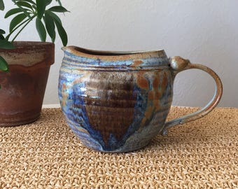 Blue and Brown Pottery Pitcher