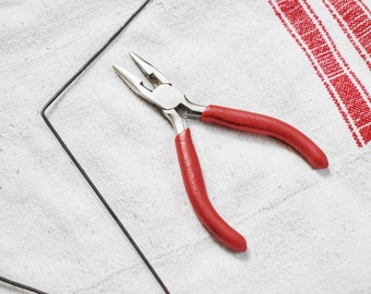 Tapered flat pliers for jewellery and wire work. tool for wire work