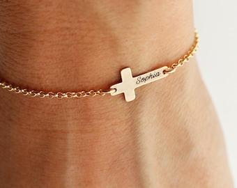 Personalized sterling silver cross bracelet.